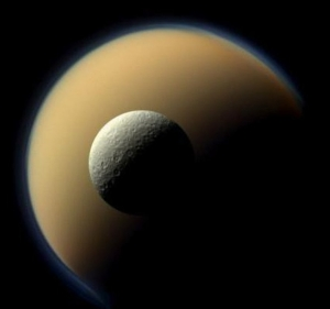 Rhea, Saturn's second largest moon passes in front of the largest, Titan